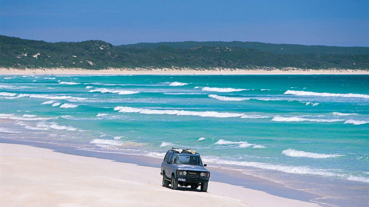 4WD on a beach near Perth