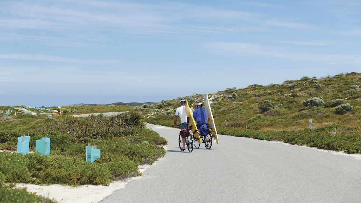 Two riders riding to surfing break at Rottnest