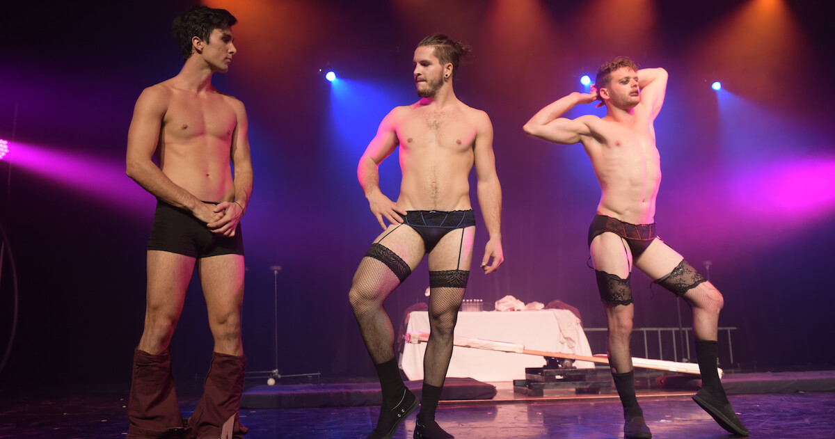 Three fit & sexy men wearing undergarments on stage