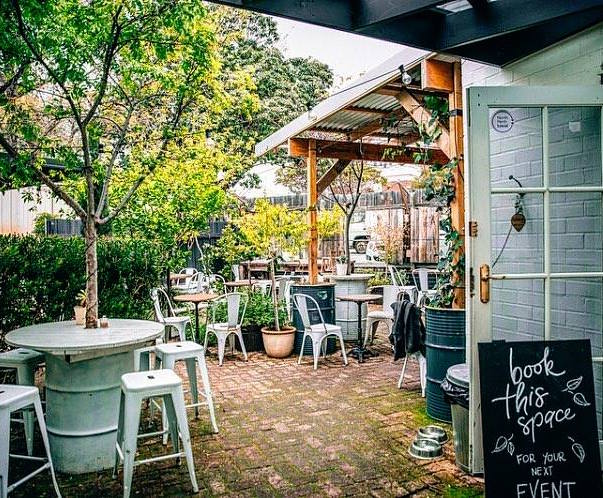 the outside alfresco area of Stomp coffee showing a garden