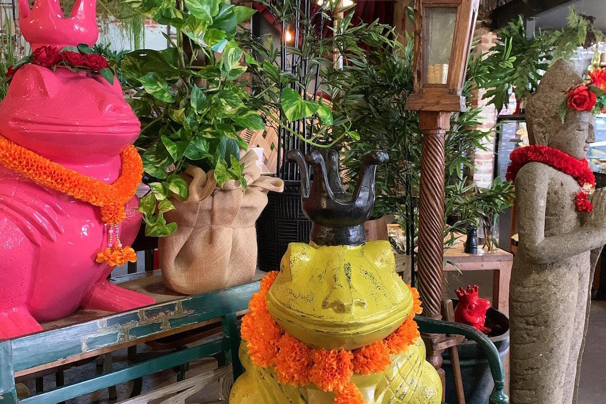 Indonesian style sculptures and a garden inside Chinta cafe