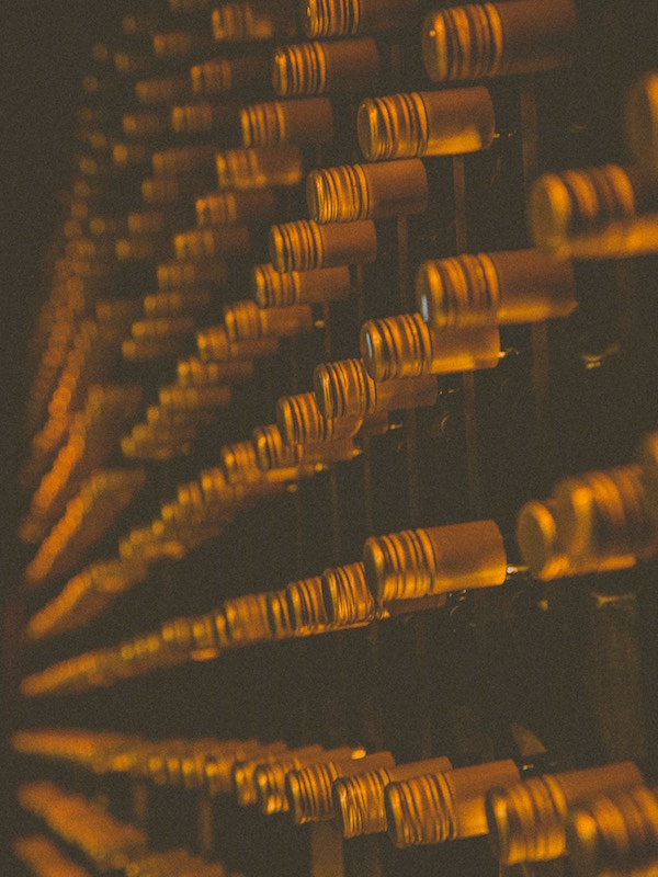 wine bottles on the wall at gold bar