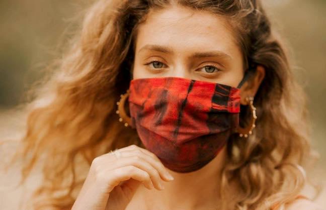 A woman wearing a reusable face mask