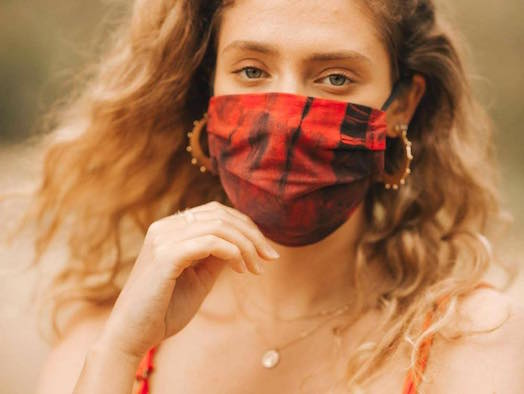 Woman wearing a reusable face mask