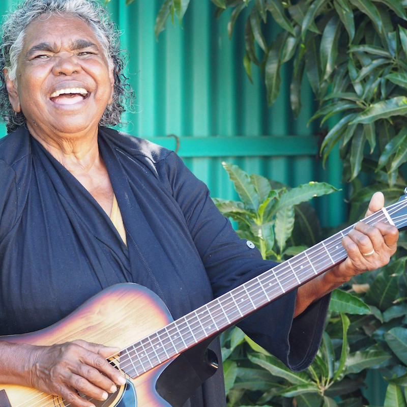 Festival Aboriginal performer, Olive Knight with a guitar