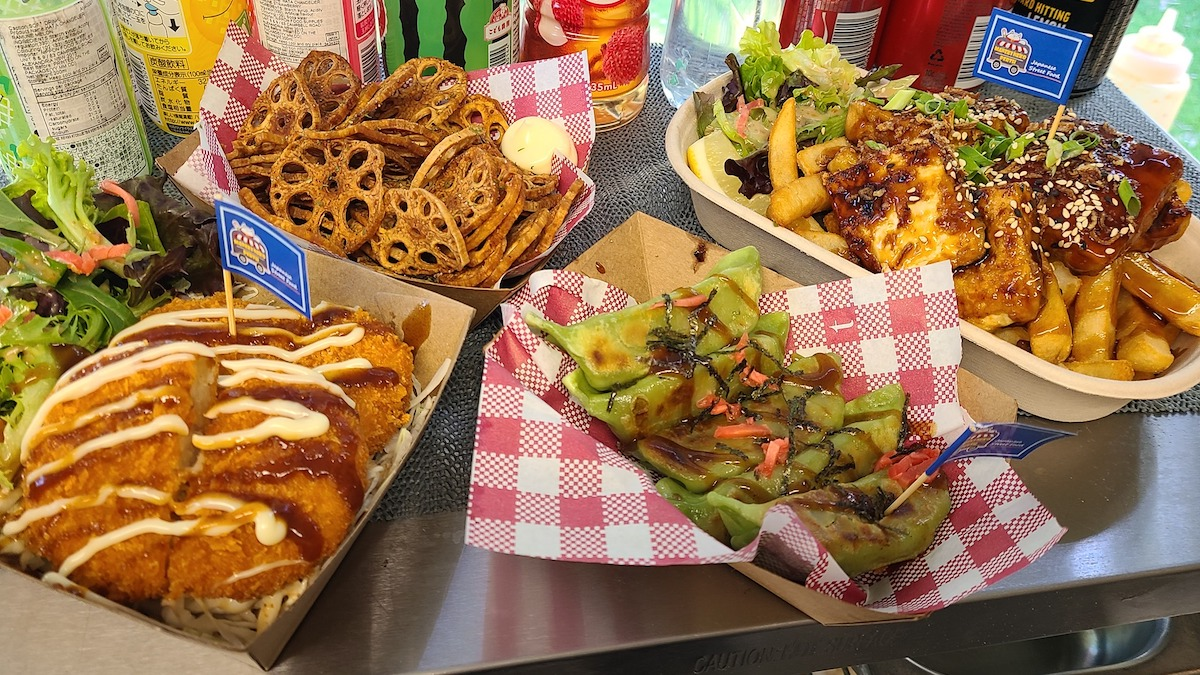 Four dishes from one of Perth's hawkers markets. There is loaded chips, lotus chips, crumbed chicken and green dumplings.