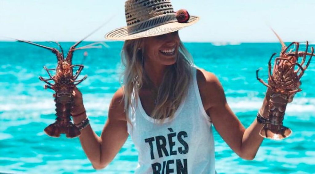 girl on a cruise holding lobster