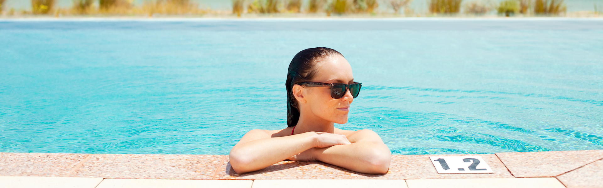 image of a woman in the Seashells infinity pool