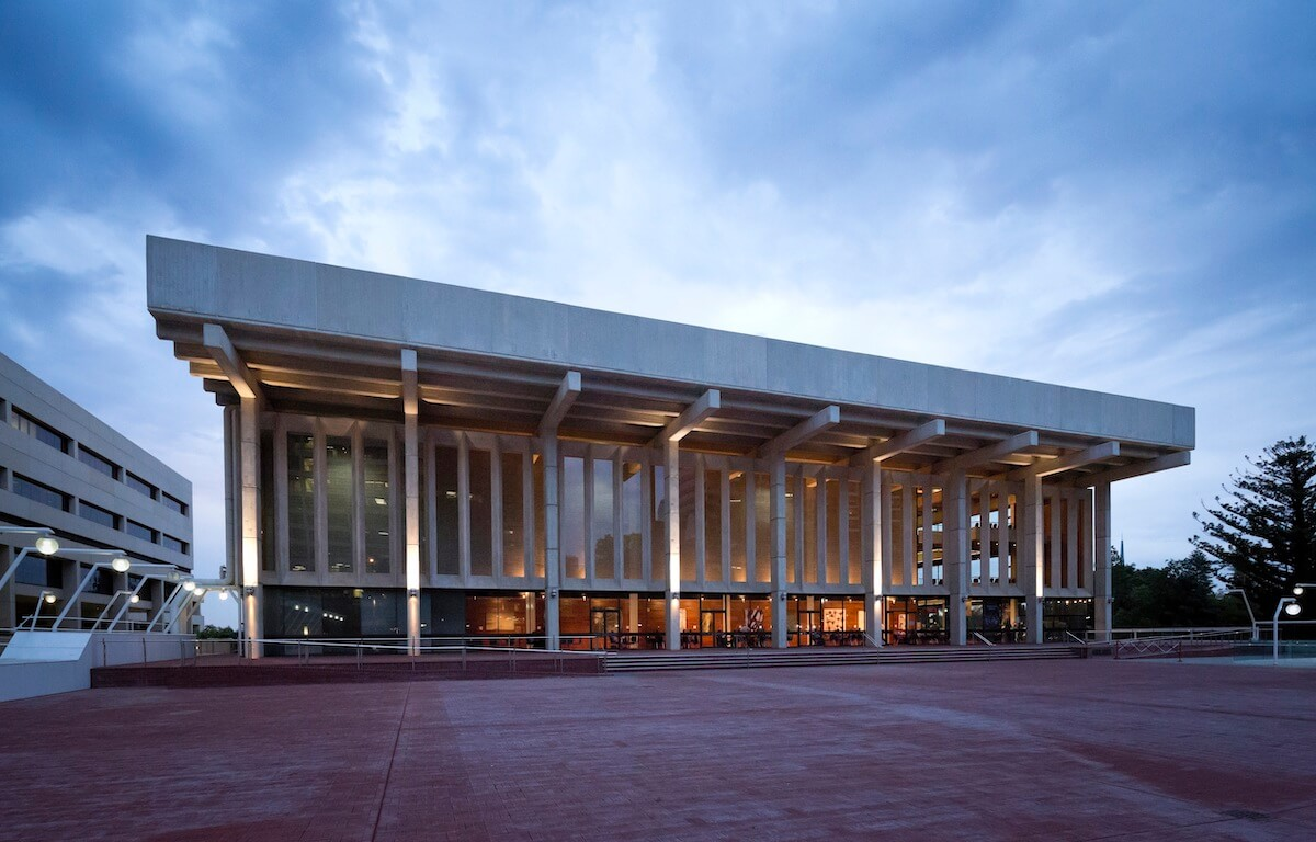 Exterior of the Perth Concert Hall - It is rectangular and imposing, with seven large columns connecting the roof to the ground.